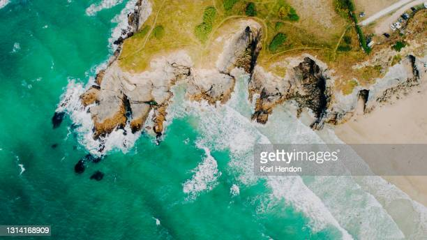 a aerial view of the cornish coastline, uk - stock photo - drone point of view stock pictures, royalty-free photos & images