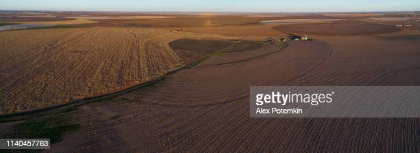 aerial view of the cotton fields ready for harvesting at sunset in autumn, texas, usa - cotton harvest stock pictures, royalty-free photos & images
