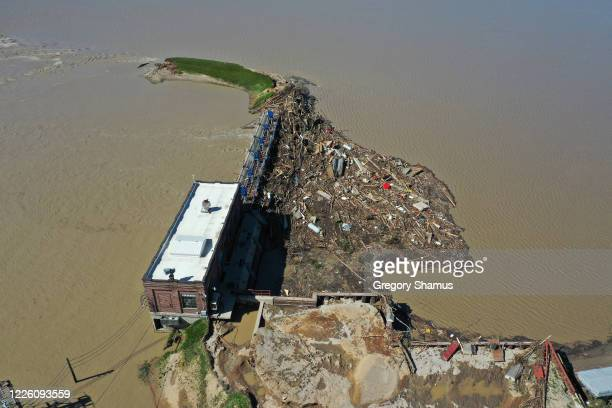Aerial view of the dam that the Tittabawassee River breached on May 20, 2020 in Sanford, Michigan. Thousands of residents have been ordered to...