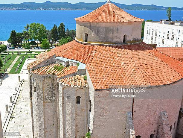Aerial view of the double domed roof of St donatus byzantine church in Zadar Croatia with Adriatic in the background