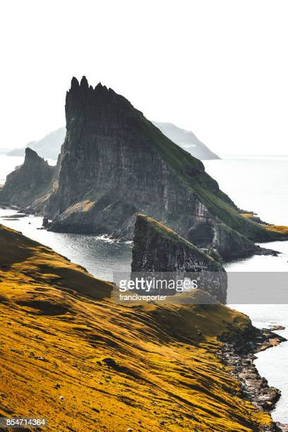 aerial view of the dranganir rock at the faroe islands - rock formation stock pictures, royalty-free photos & images