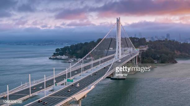 aerial view of the dwight d. eisenhower highway at sunset - oakland california stock pictures, royalty-free photos & images