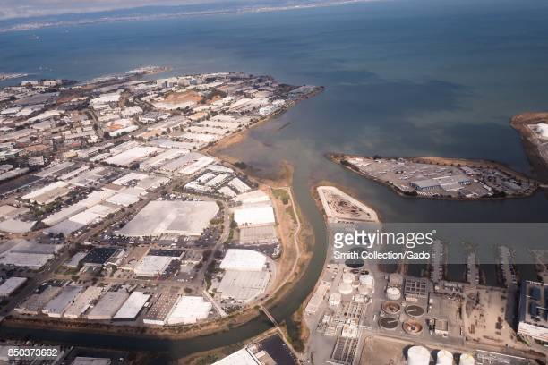 Aerial view of the East Side neighborhood of South San Francisco California including the Samtrans bus yard San Bruno Canal San Francisco Bay and...