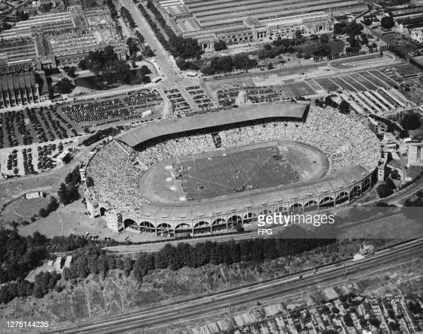 Aerial view of the Empire Stadium, showing 100,000 spectators watching the events on the third day of the 1948 Summer Olympics in London, England,...