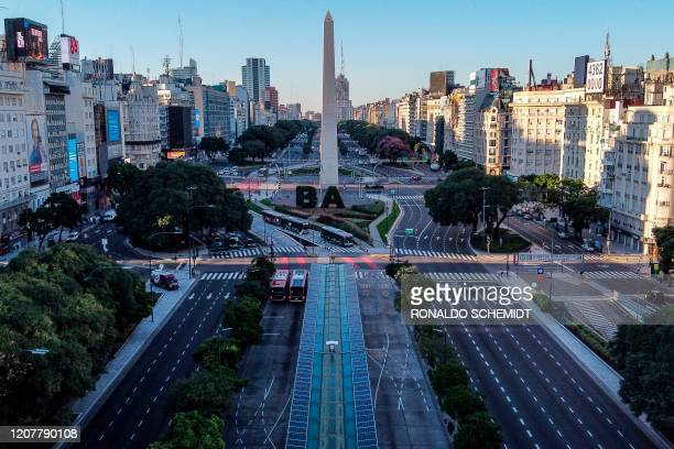 Aerial view of the empty 9 de Julio avenue in Buenos Aires, on March 20, 2020. - Argentine President Alberto Fernandez on Thursday announced a...