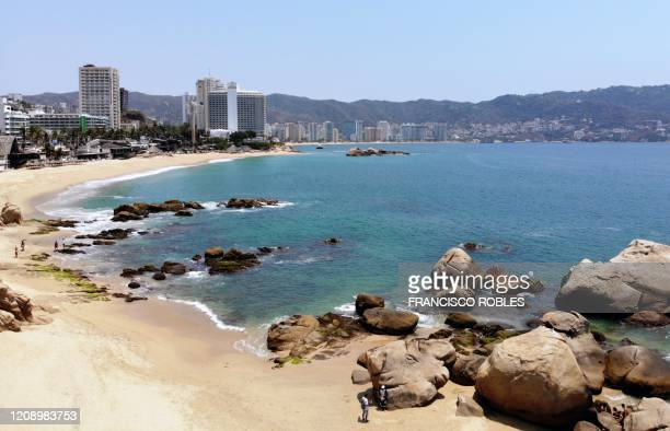 Aerial view of the empty beach in Acapulco, Guerrero state, Mexico on April 2, 2020. - More than 20,000 cases of COVID-19 were registered in Latin...