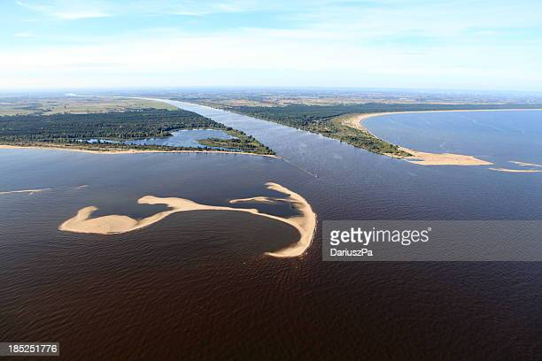 aerial view of the estuary. vistula river - estuary stock photos and pictures