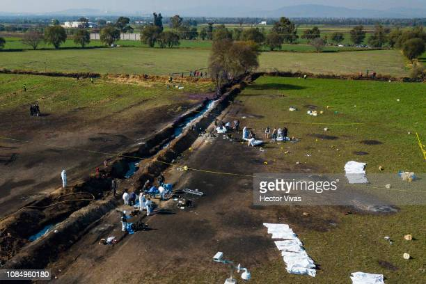Aerial view of the explosion site of a pipeline belonging to Mexican oil company PEMEX on January 19 2019 in Tlahuelilpan Mexico In a statement PEMEX...