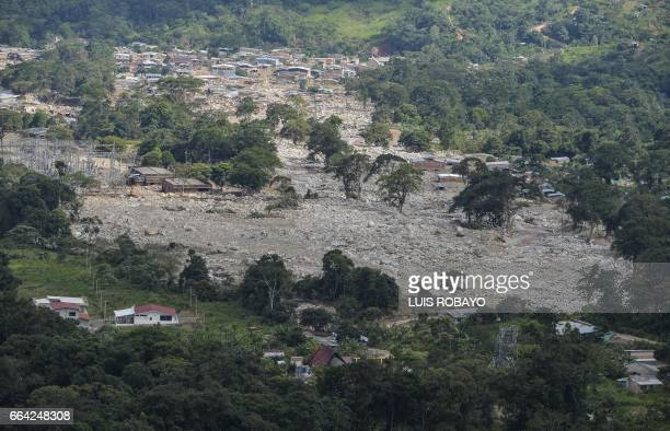 Aerial view of the extensive damage caused by mudslides as a result of heavy rains in Mocoa Putumayo department Colombia on April 3 2017 Rescuers...