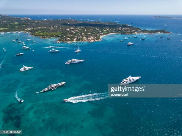 aerial view of the famous costa smeralda, sardinia, italy. - luxury yacht stock pictures, royalty-free photos & images