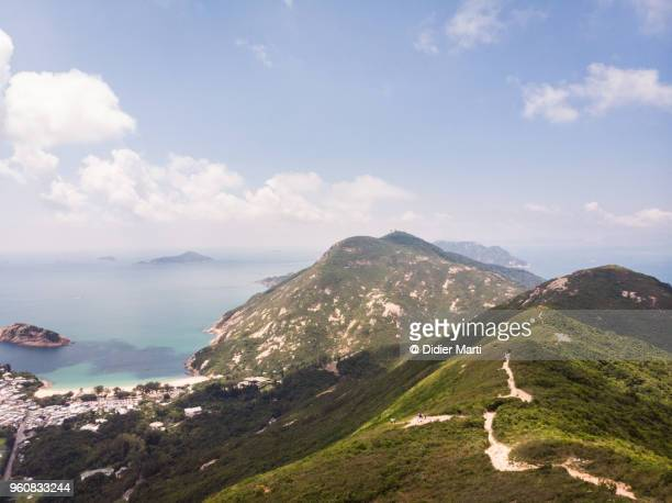 Aerial view of the famous Dragon back hiking trail with the Shek O village by the sea in Hong Kong island