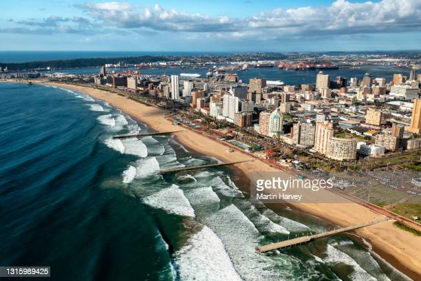 aerial view of the famous durban beach front with the harbour in the background,kwazulu-natal, south africa - durban stock-fotos und bilder