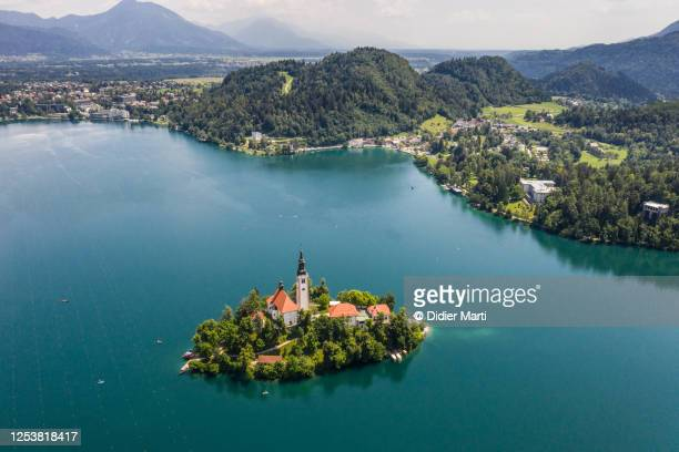 aerial view of the famous lake bled with its island with a church, an icon of slovenia. - balkans stock pictures, royalty-free photos & images