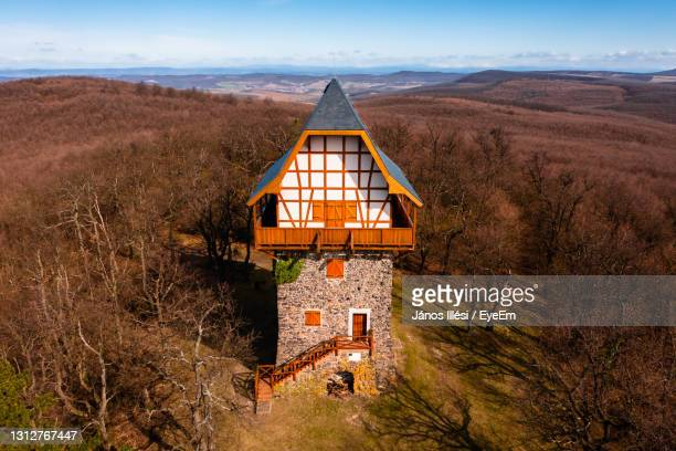 aerial view of the famous sasberc lookout tower which is the highest point of cserhat mountain. - hungary stock pictures, royalty-free photos & images