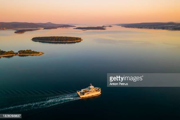 aerial view of the ferry at sunset. adriatic sea, croatia - ferry stock pictures, royalty-free photos & images