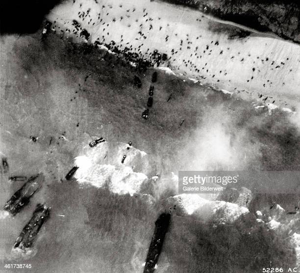 Aerial view of the first landing with landing craft and allied soldiers 6th June 1944 Utah Beach Normandy France
