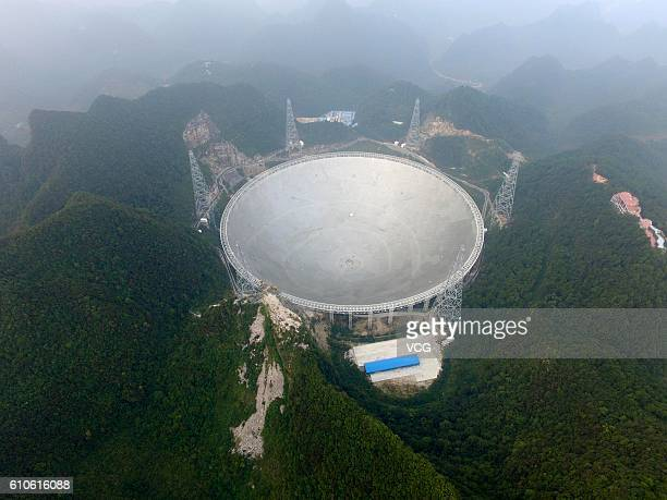 Aerial view of the Fivehundredmeter Aperture Spherical radio Telescope in operation on September 25 2016 in Qiannan Buyei and Miao Autonomous...