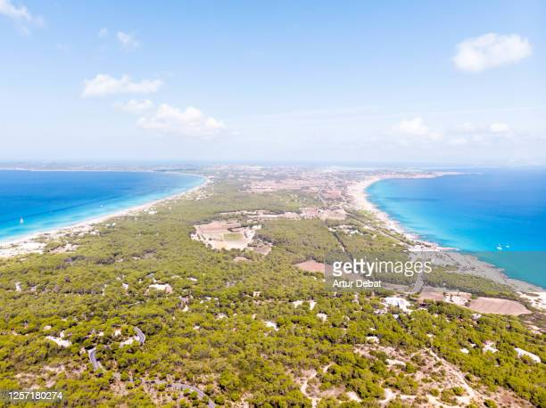 aerial view of the formentera island with paradise beach in the mediterranean sea. toma aérea de la isla de formentera con playas paradisiacas. - vista aérea stock pictures, royalty-free photos & images