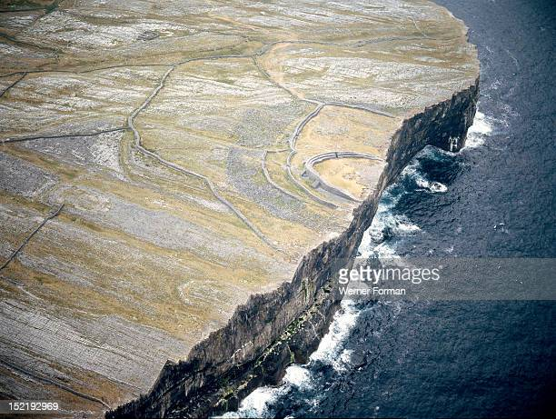 Aerial view of the Fort of Dun Aengus The fort is encirled by a triple line of high drystone walls Said to be built by the mythical race the Fir...