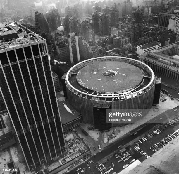Aerial view of the fourth Madison Square Garden, located on 33rd Street between 7th and 8th Avenues, taken soon after its completion, New York City,...