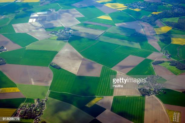 aerial view of the french countryside before paris,france - cultivated land stock pictures, royalty-free photos & images