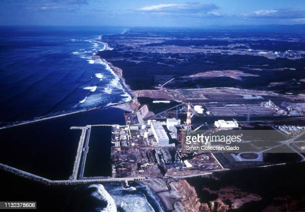 Aerial view of the Fukushima Daiichi Nuclear Power Plant, straddling the Pacific Ocean coastline, Fukushima, Japan, 1971. Image courtesy US...