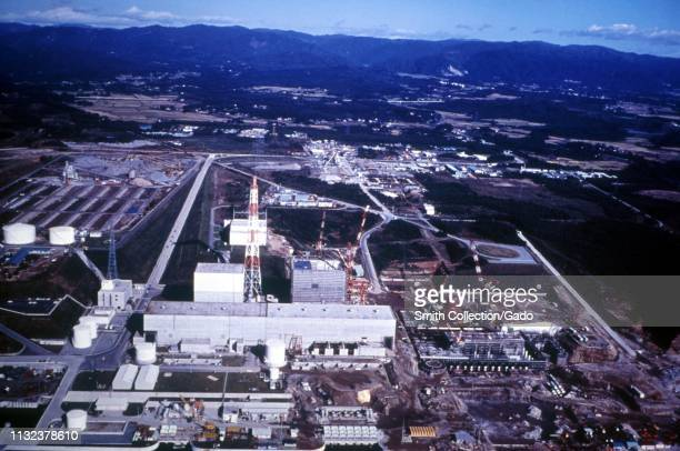 Aerial view of the Fukushima Daiichi Nuclear Power Plant with mountains in the background Fukushima Japan 1971 Image courtesy US Department of Energy