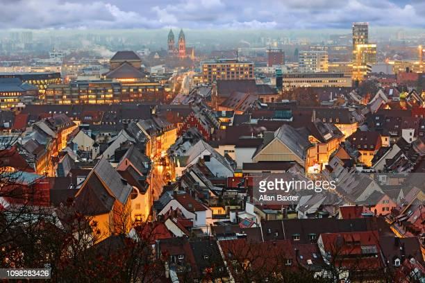 aerial view of the german city centre of freiburg at dusk - フライブルク・イム・ブライスガウ ストックフォトと画像