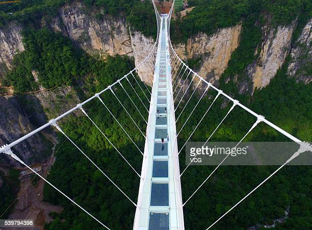 Aerial view of the glassbottomed bridge across the Zhangjiajie Grand Canyon on June 12 2016 in Zhangjiajie Hunan Province of China World's longest...