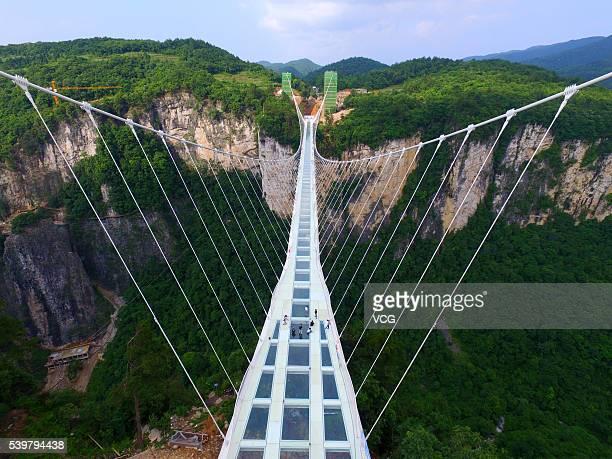 Aerial view of the glass-bottomed bridge across the Zhangjiajie Grand Canyon on June 12, 2016 in Zhangjiajie, Hunan Province of China. World's...