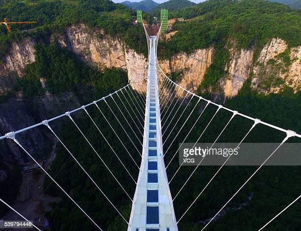 Aerial view of the glassbottomed bridge across the Zhangjiajie Grand Canyon on June 12 2016 in Zhangjiajie Hunan Province of China World's longest...