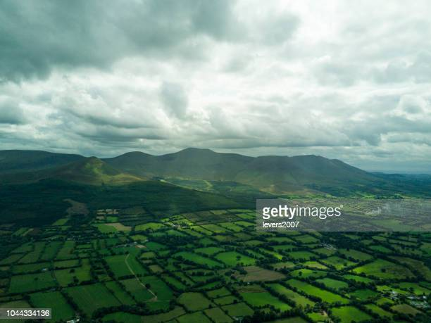 aerial view of the glen of aherlow, co. tipperary, ireland. - organic farm stock photos and pictures
