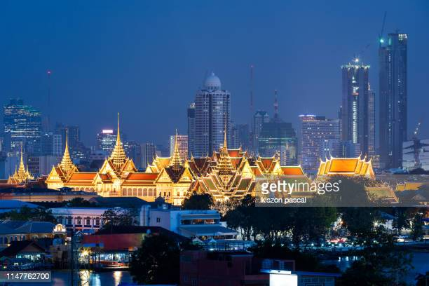 aerial view of the grand palace in bangkok illuminated at night . thai culture . - grand palace bangkok stock pictures, royalty-free photos & images