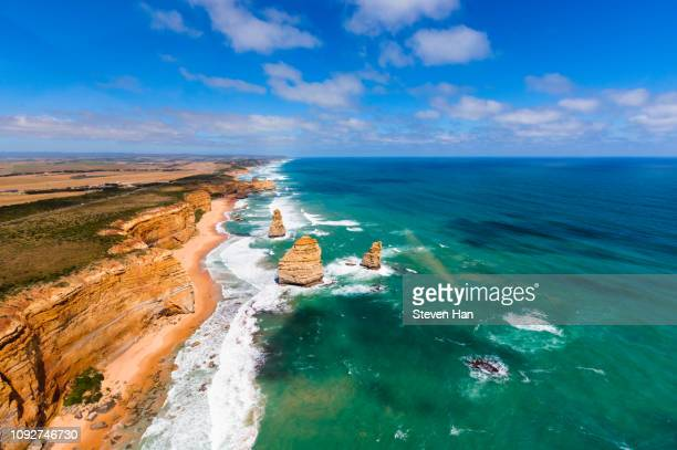 aerial view of the great ocean road and the twelve apostles near melbourne - coastline stock pictures, royalty-free photos & images
