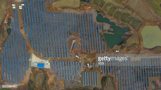 Aerial view of the gridconnected photovoltaic system built on an abandoned mine at Chihe Town on January 23 2017 in Chuzhou Anhui Province of China...