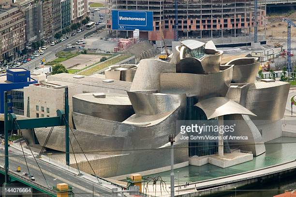 """Aerial view of the Guggenheim Museum of Contemporary Art of Bilbao located on the North Coast of Spain in the Basque region, Nicknamed """"The Hole"""",..."""