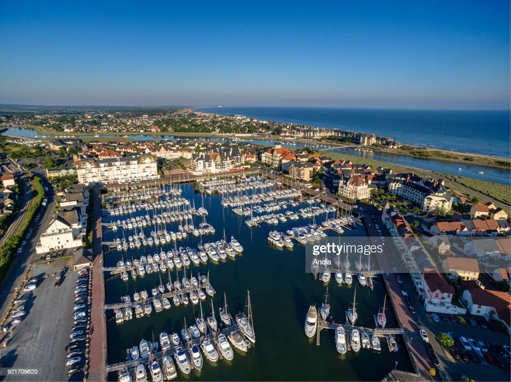 Aerial view of the harbour of Dives-sur-Mer along the 'cote Fleurie', coast of Normandy. Sailing ships alongside the quay in the marina.