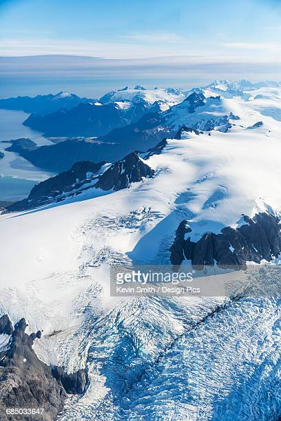 aerial view of the harding ice field and glaciers decending from its snowy peaks, prince william sound in the background, kenai peninsula, southcentral alaska - golfo do alasca imagens e fotografias de stock