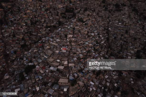 Aerial view of the high density of houses in the neighborhood of Jalousie in the commune of Petion Ville PortauPrince on December 16 2018 Jalousie is...