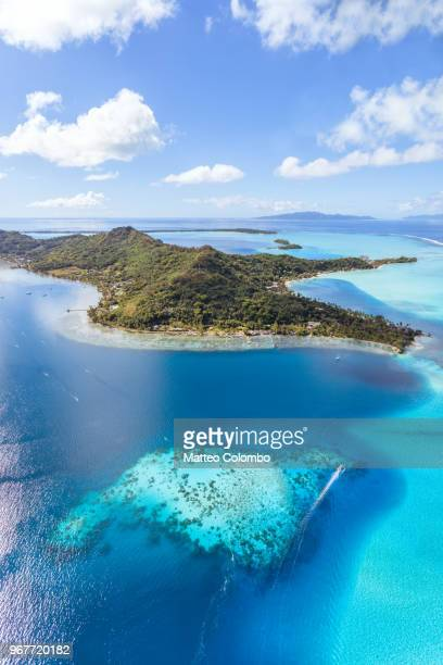 aerial view of the island of bora bora, french polynesia - lagoon stock pictures, royalty-free photos & images