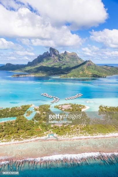 aerial view of the island of bora bora, french polynesia - bora bora stock pictures, royalty-free photos & images