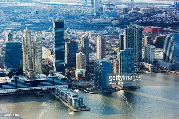 aerial view of the jersey city waterfront at dusk - newark new jersey stock pictures, royalty-free photos & images