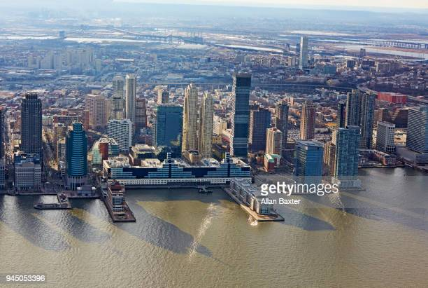 aerial view of the jersey city waterfront at dusk - newark new jersey stock photos and pictures