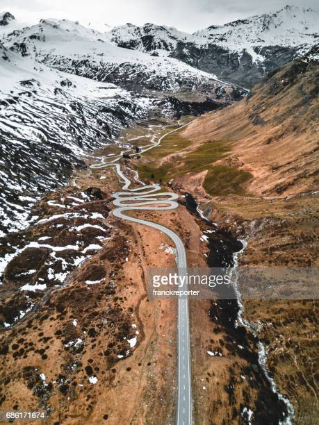aerial view of the julierpass in switzerland - hairpin curve stock photos and pictures