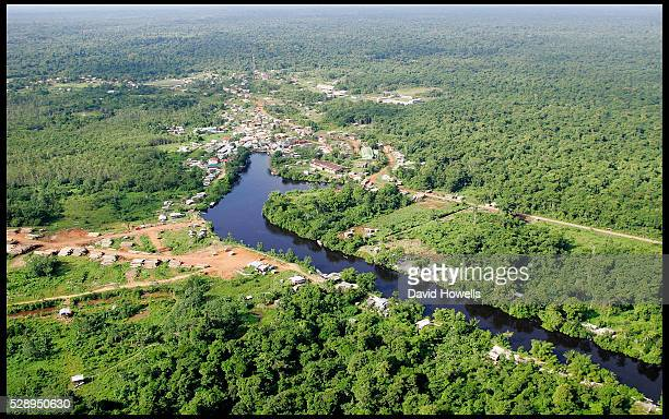 Aerial view of the jungle town of Port Kaituma, Guyana. The town is known for the Jonestown massacre that happened nearby, and for the shootings of...
