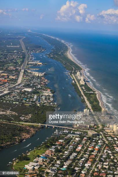 aerial view of the jupiter beach inlet - juno beach florida stock pictures, royalty-free photos & images