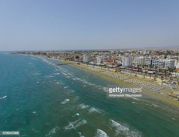 Aerial view of The Larnaca seafront and Phoinikoudes beach on May 1 2016 in Larnaca Cyprus Athinon Avenue located at Foinikoudes promenade Larnaca is...