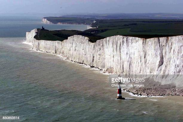 Aerial view of the Lighthouse and cliffs at Beachy Head in East Sussex incl the Belle Tout lighthouse in the distance 18/01/04 A man was repeatedly...