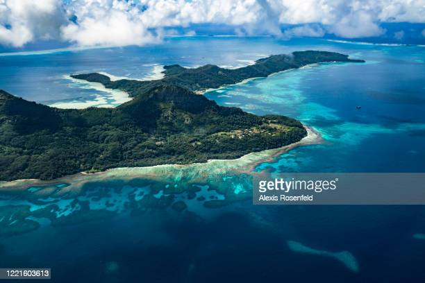 Aerial view of the little town of Rikitea in Mangareva Island on February 20 Gambier Islands, French Polynesia, South Pacific. Majority of the...