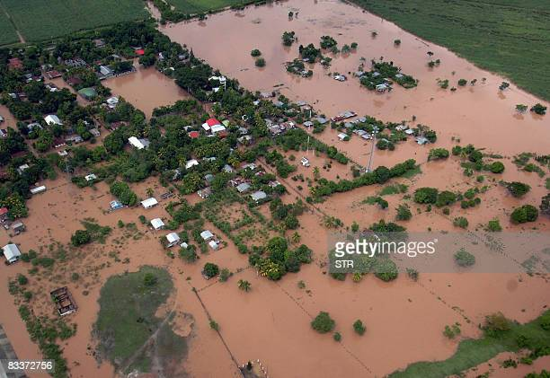 Aerial view of the locality of Reyes Caballero after the overflowing of the Chamelecon river in the municipality of La Lima department of Cortes some...